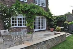 Sandstone is a versatile natural stone.  Used to beautiful effect in this traditional Surrey garden