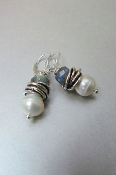 These classic earrings are made with a 12mm teardrop freshwater white pearl, an 8mm firey blue labradorite and two silver oxidized love knots. They hang from a sterling silver lever back ear wire. They measure 1 1/2 inches from the tops of the ear wires to the bottom of the pearls. Enjoy....