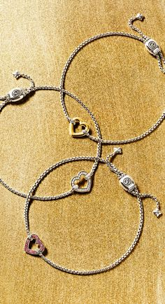 Cable Collectibles® heart bracelets.