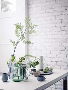 A refreshingly simple yet effective table display of feathery ferns and delicate flowers. Homes & Gardens, July 2015. Styling Sally Conran. Photographs Simon Bevan. http://www.hglivingbeautifully.com/2015/06/06/the-garden-room/
