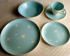 Six Harkerware Star-Lite place settings, olympic-white stars, light teal background, atomic retro pattern.