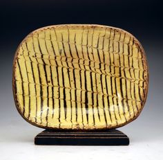 ... comb decorated baking- loaf dish English Earthenware late 18thc