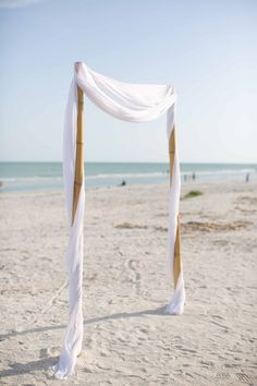 Simple Beach Setting | Laura Elizabeth Photography | Read More: http://stylemepretty.com/2013/08/29/sanibel-island-florida-wedding-from-laura-elizabeth-photography/
