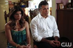 """Jane The Virgin -- """"Chapter Fourteen"""" -- Image Number: JAV114a_0556.jpg -- Pictured (L-R): Andrea Navedo as Xo, Jaime Camil as Rogelio and Gina Rodriguez as Jane (back to camera) -- Photo: Greg Gayne/The CW -- © 2015 The CW Network, LLC. All rights reserved."""