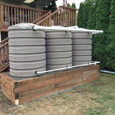#rainwaterharvesting installation in West Seattle.  3 x 420 gallon tanks. Overflow to front sidewalk.