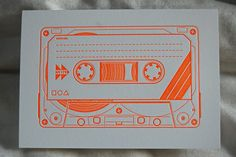 Image from http://gentlepurespace.com/blog/wp-content/uploads/2008/10/letterpress-cassette-tape-card.jpg.