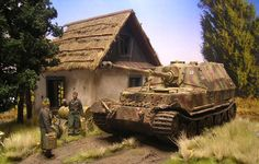 """Diorama by Christian Schiller shows one of the """" Ferdinand """" at Resupply the spring of 1944 in a seemingly idyllic scene near a Ukrainian , small residential building ."""