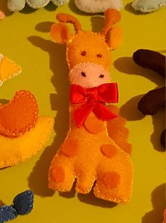 Guarda questo articolo nel mio negozio Etsy https://www.etsy.com/it/listing/508547371/bomboniera-giraffa-in-pannolenci