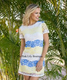 We just adore the color combination of this gorgeous dress! Features white, blue, and yellow lace over a white lining, short sleeves, and a zipper in the back.