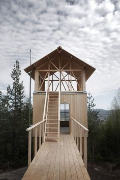 Timber-framed cabin by Hanna Michelson stands on stilts to peep over the treetops of Swedish mountain