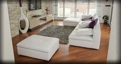 Divano a contrasto - Per dare più carattere all'arredamento, scegliete un tappeto grigio in abbinamento a divano bianco e parquet