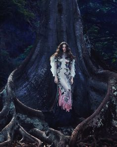 Looking ethereal, Ali Michael poses in a Gucci embroidered dress with feathers for How to Spend It Magazine November 2016 issue