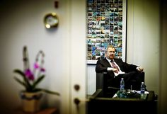 """Maersk Line CEO Søren Skou in his office. On the wall behind him is the original """"The wall of #maersk"""", made up by Instagram photos taken by our fans/followers. Learn more: http://maersklinesocial.com/the-wall-of-maersk/"""