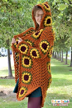 This vintage look crochet sunflower cardigan coat is long, comes with a fairy tale style hood & fun side slits. The sunflower granny square is easy to make as it's only 4 rounds. This free pattern comes in 9 sizes & includes a YouTube video tutorial. Joining Granny Squares, Flower Granny Square, Crochet Sunflower, Bobble Stitch, Coat Patterns, Stitch Markers, Double Crochet, Vintage Looks, Free Crochet