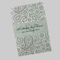This gatefold wedding invite with a translucent belly band is printed with a silver paisley pattern. This is just one of more than 50 colours which can be used for this pattern. The wedding celebration details are printed on an insert inside the gatefold. www.kardella.com