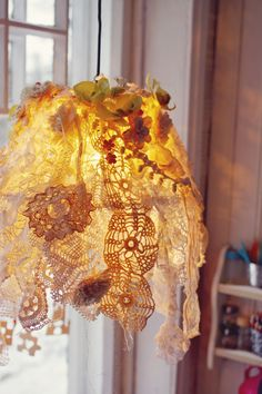 lacey lampshade - something to do with all those odd bits of lace and doilies that I have add flowers to the top end