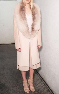 This **Sally LaPointe** Fox Fur Coat is rendered in luxurious cashmere and features a fox fur collar and leather sleeves.