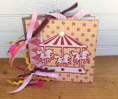 Carnival Circus Scrapbook Photo Memory Book Keepsake Album Chipboard 6x6 Vintage Shabby An adorable circus/carnival themed chipboard scrapbook album! This 6x 6 keepsake album is made with 6 sturdy chipboard pages. It holds 10 pictures (each photo mat measures 4 1/4 x 5 1/4 and