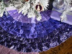 Make a no-sew ruffled ombre Christmas tree skirt.