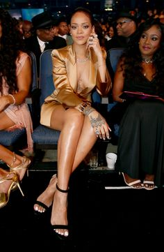 Rihanna wears a short gold suit to the 2015 BET Awards