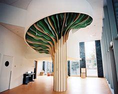 studio millimètre installs six meter high tree in paris nursery