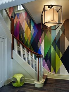 Bold, colorful and geometric wallpapers. I love this for a stairwell.