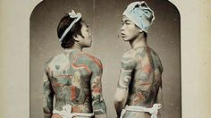 Two Japanese men (ca. 1880s) reveal their backs, heavily covered in fearsome tattoos. #seriouslyamazing