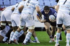 Montpellier's French prop Ivan Watremez (C) vies with Racing-Metro's players during the French top 14 rugby union match Racing Metro 92 vs Montpellier on October 6, 2012 at the Yves du Manoir stadium in Colombes, outside Paris . AFP PHOTO / FRED DUFOUR