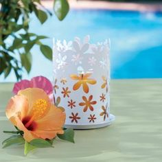 Turn any pillar candle into a summer sensation with a pierced metal sleeve encircled with blossoms. The Blossom Candle Sleeve by PartyLite® Candles (Summer Catalog 2013)