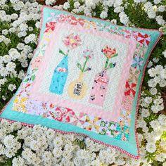 @ lovely little handmades: Flowers in Vintage Bottles - gorgeous cushion by Kerri - link to purchase pattern for bottles: https://www.etsy.com/listing/173384714/flowers-in-vintage-bottles-a-paper?ref=shop_home_active_11