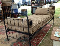 My antique twin bed with a French ticking Matress, neck roll(s) and pillow, custom made for this size twin. . Beautiful and comfy too!