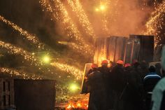Best photographs of 2014 – in pictures   Ukrainian protesters launch a fire attack on police in Grushevsky Street, Kiev, on 22 January.  Photograph: Vladislav Sodel/Kommersant/Getty Images