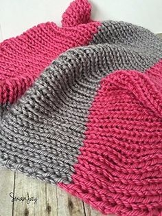 Chunky Knitted Baby Blanket Thick Nursery Decor Big Knit Throw Pink Gray Bulky Knitted Blanket Shower Gift Grey. This beautiful handmade blanket is knit with soft, super bulky acrylic yarn in a pink and grey color combination. The ribbed texture is stretchy and extra-soft, creating a cozy, warm addition to a nursery. This blanket is great for the stroller, rocking chair, or as a baby shower gift. Machine washable and dryer safe, though it is recommended that you hand wash and lay flat to...