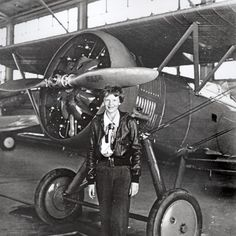 Stock Photo - Aviation pioneer Amelia Earhart poses with her airplane in a hangar July Earhart was the first female aviator to fly solo across the Atlantic Ocean Amelia Earhart Picture, Amelia Earhart Plane, Amelia Earhart Quotes, Female Pilot, National Weather, Pilot License, Vintage Airplanes, Women In History, In Boston