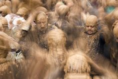 """""""Ashura Mud Men"""". Iranian shi'a muslim men, in trance and covered in mud, mourning during the Day of Ashura, on which shi'a muslims commemorate the martyrdom of Husayn, grandson of Muhammad, and third shi'a imam. The mud is an important part of the local mourning ritual. Shot in the town of Bijar, Iran. (Photo and caption by Guido Dingemans/National Geographic Traveler Photo Contest)"""