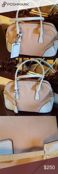 """PRADA CANVAS HANDBAG TAN SATCHEL WITH LOCK AND KEY This handbag features a canvas body, rolled leather handles, a top zip closure, and an interior zip pocket.   Measurements: 15.6""""L X 4.72"""" X 10.63""""W.  The tag inside reads 53. Prada Bags Satchels"""