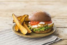 This non-traditional vegetarian take on a burger will blow you away! Salty and savoury halloumi tossed in Cajun seasoning pairs perfectly with sweet potato fries and garlicky mayo. You'll love the rich toasted flavour that pan-fried halloumi gets. Burger Recipes, Potato Recipes, Veggie Recipes, Vegetarian Recipes, Savoury Recipes, Veggie Food, Lunch Recipes, Easy Recipes, Healthy Recipes
