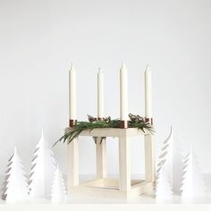 Build this Scandinavian style Advent cube candle holder out of simple and easy to find things from the home improvement store.