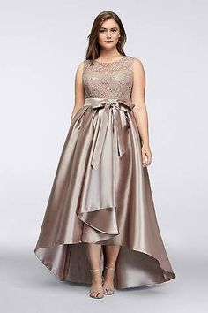 4021e31ff247 Perfect for a dressy wedding, this mother of the bride dress has a sequined  lace bodice and a dramatic mikado skirt punctuated by a ladylike sash.