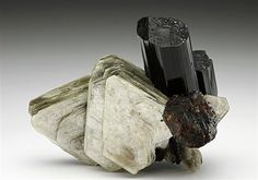 Schorl Tourmaline with Spessartine and Muscovite. A fine combination specimen from the pegmatite rich area of Teston, Pakistan. Crystal Classics Minerals