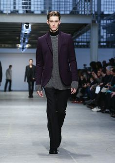 A model walks the runway during the Costume National Homme show as a part of Milan Fashion Week Menswear Autumn/Winter 2014 on January 11, 2...