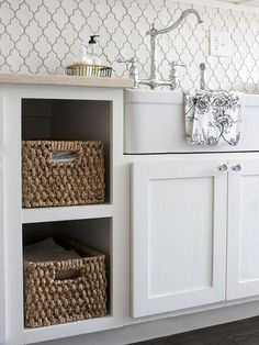 Serving Pieces--The Perfect Sidekick--Open storage helps make small kitchens appear larger. Here, a cabinet front was removed in favor of a more convenient, drawerlike solution. Now a pair of decorative baskets fills the space to house napkins, oven mitts, and table linens.