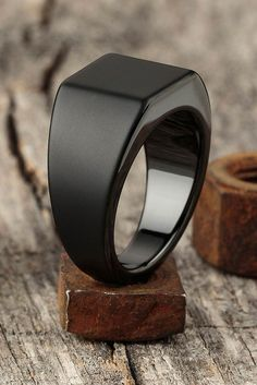"Made from tungsten, the Lourd is by far our weightiest ring, and fittingly takes. Made from tungsten, the Lourd is by far our weightiest ring, and fittingly takes it's name from the French word for ""heavy."" Based on a classic school. Ring Verlobung, Signet Ring, Black Rings, Men's Accessories, Matte Black, Jewelry Rings, Jewellery, Gold Jewelry, Jewelry Quotes"