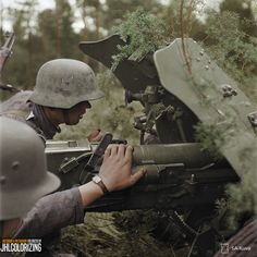 """Finnish soldiers with Soviet """"war trophy"""" 45mm anti-tank gun in Ilmee area August 7 1941. Notice that Finnish swastika in Hungarian M/38 helmet. This particular swastika has no relation to Nazism. Sa-kuva"""