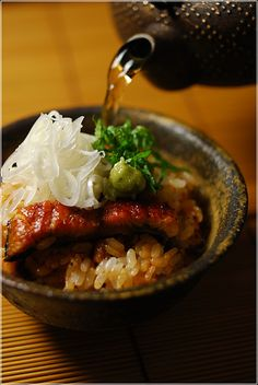 Japanese food -Hitsumabushi Chazuke-: eel fillets cooked over charcoal with soy flavoured sauce, cut in small pieces and serve on rice with hot tea.
