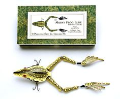"Musky Frog LureMade exclusively for the Black Lake Angler's Association by the Macatawa Bait Co of Holland, Michigan. The lure measures 12 ½"" and has glass eyes."