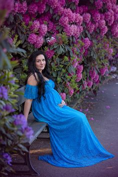Maternity photography Leeds, Yorkshire, pregnancy session Leeds: beautiful pregnant woman with long black hair sitting on a bench in a spring garden