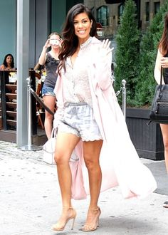 Pregnant Kourtney Kardashian concealed her baby bump in lingerie-inspired shorts during an outing in NYC's Meatpacking District as she filmed her reality spinoff  Kourtney and Khloe Take the Hamptons .