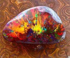 """The """"Sunburst"""" ....a beautiful boulder opal...47mmx30mm."""