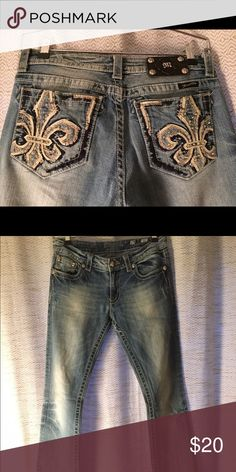 Miss me jeans Miss me jeans with a Fleur de lie on each back pocket with rhinestone embellishments. Some wear on the heels. Miss Me Jeans Boot Cut